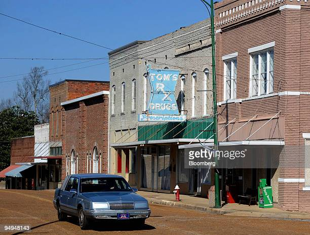 A vehicle drives along Main Street in Baldwyn Mississippi US on Sunday Feb 22 2009 Baldwyn Mississippi was perhaps best known for its proximity to...