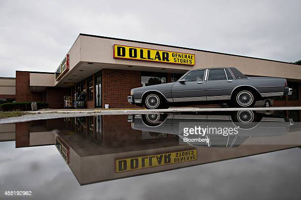 A vehicle drives past a Dollar General Corp store in Silvis Illinois US on Wednesday Sept 10 2014 Dollar General Corp spurned twice in attempts to...