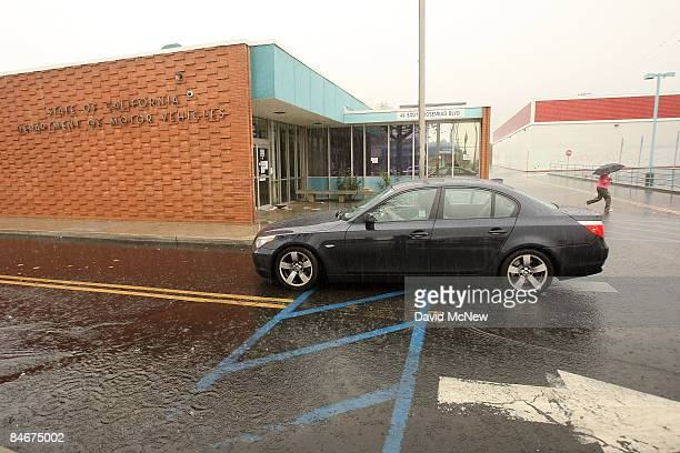 A vehicle drives past the State of California Department of Motor Vehicles February 6 2009 in Pasadena California The DMV is closed as part of the...