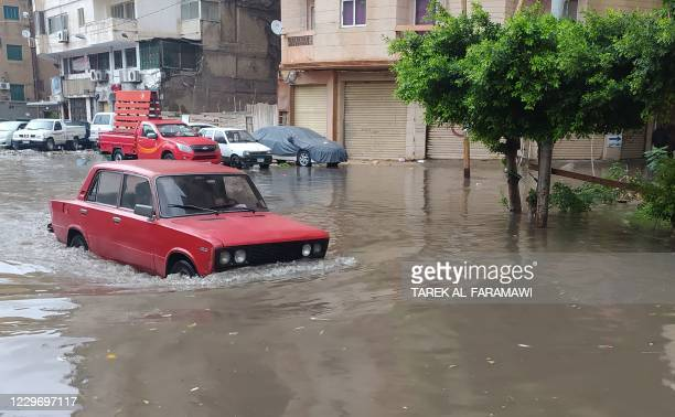 Vehicle drives through a flooded street due to heavy rain in the Egyptian coastal city of Alexandria on November 20, 2020.