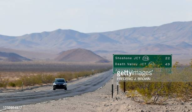 Vehicle drives through Death Valley, California, on July 11, 2021 as California where temperatures hit 120 degrees this weekend as California is...