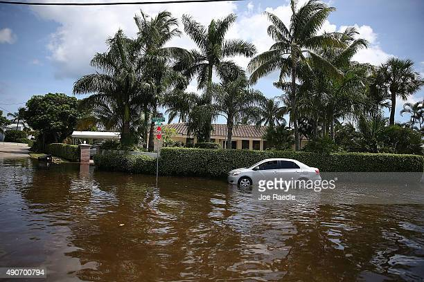 Vehicle drives through flooded streets caused by the combination of the lunar orbit which caused seasonal high tides and what many believe is the...