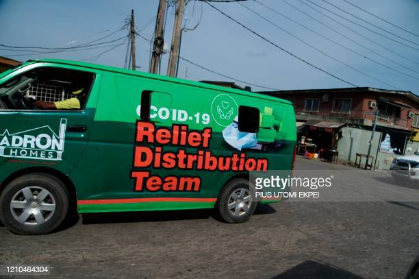Vehicle drives to distribute relief palliatives to cushion the effect of lockdown to prevent the spread COVID-19 coronavirus in Lagos, on April 20,...