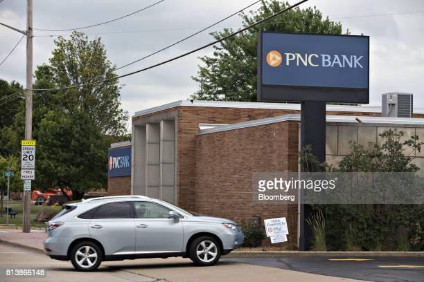 A vehicle enters a PNC Financial Services Group Inc bank branch parking lot in Morton Illinois US on Monday July 10 2017 PNC Financial Services Group...