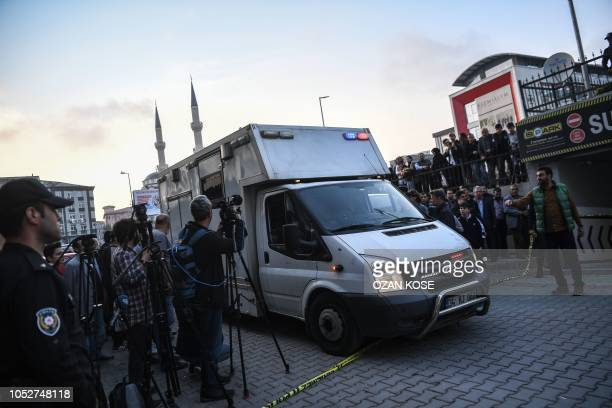 Vehicle enters the area cordoned off by Turkish police around an underground car park, on October 22, 2018 in Istanbul, after police found an...