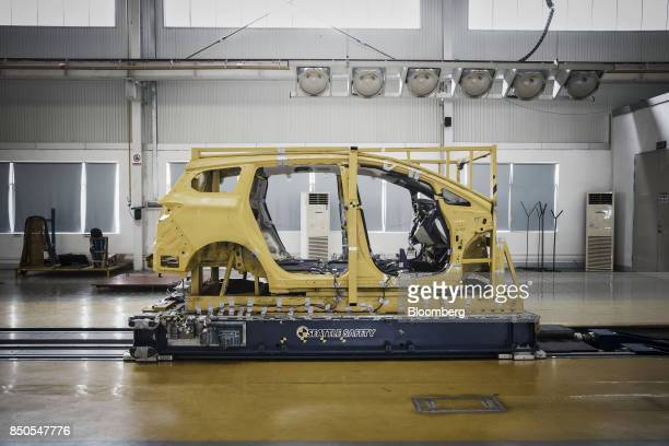 A vehicle frame sits on a Seattle Safety LLC testing sled in a lab at the BYD Co headquarters in Shenzhen China on Thursday Sept 21 2017 China will...