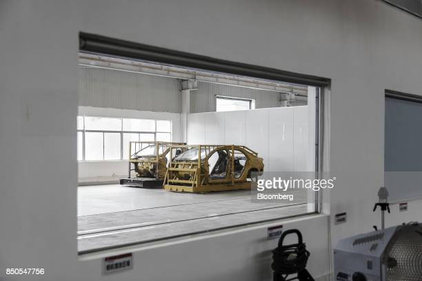 Vehicle frames sit in a testing lab at the BYD Co headquarters in Shenzhen China on Thursday Sept 21 2017 China will likely order an end to sales of...