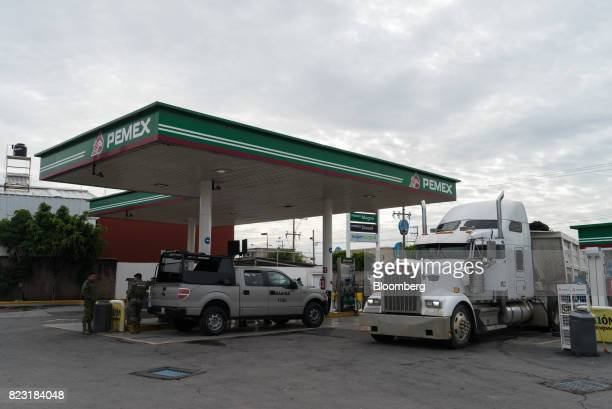 Vehicle get fuel at a Petroleos Mexicanos gas station in the city of Puebla Puebla State Mexico on Thursday July 6 2017 While buying stolen gasoline...