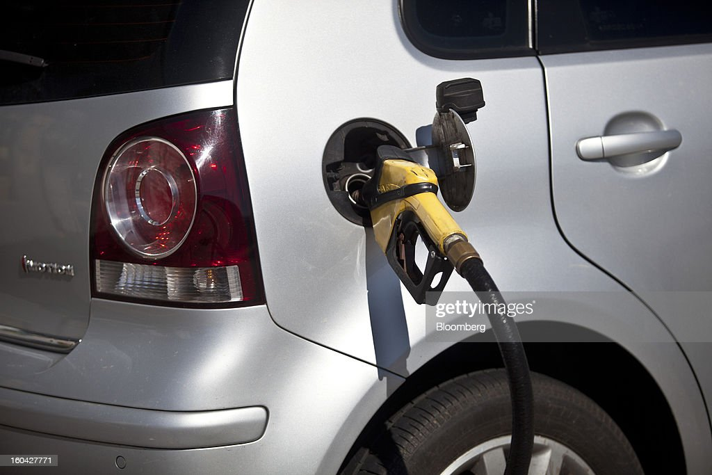 A vehicle has its tank filled at a Petroleo Brasileiro SA (Petrobras) station in Rio de Janeiro, Brazil, on Thursday, Jan. 31, 2013. State-controlled oil company Petrobras announced earlier this week that it would raise gasoline and diesel prices by 6.6 percent and 5.4 percent, respectively. Photographer: Dado Galdieri/Bloomberg via Getty Images