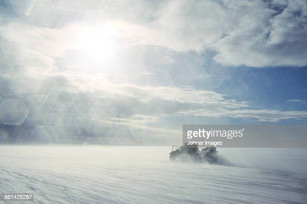 Vehicle in snowy landscape