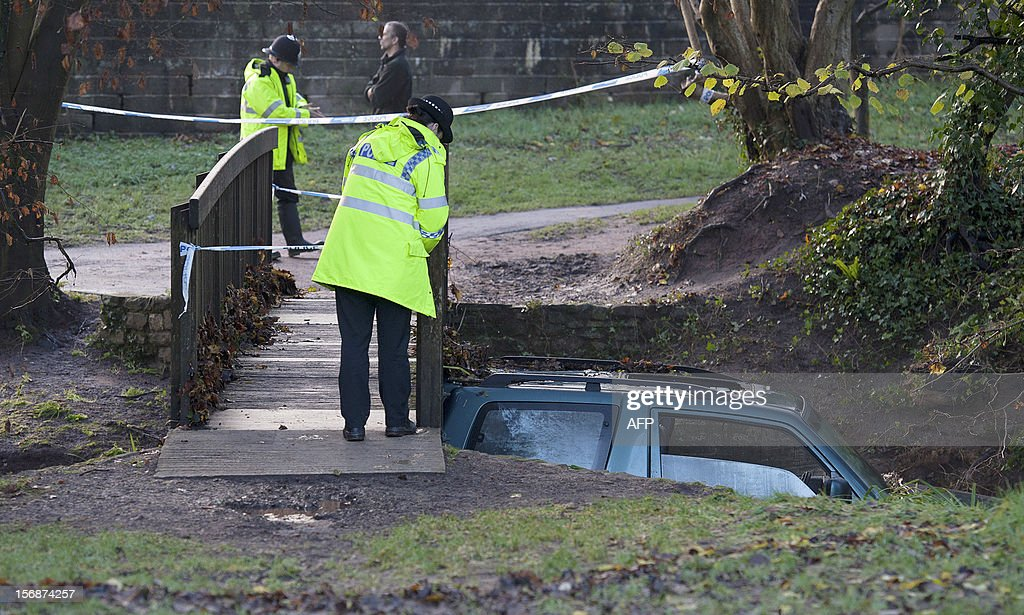 A vehicle in which a man died after being trapped in flood waters is wedged under a bridge following heavy rainfall in Chew Stoke, Somerset, southwest England, on November 23, 2012. Swathes of Britain were hit by by heavy rains and strong winds for a second day on Thursday, with authorities warning of worse flooding to come at the weekend.