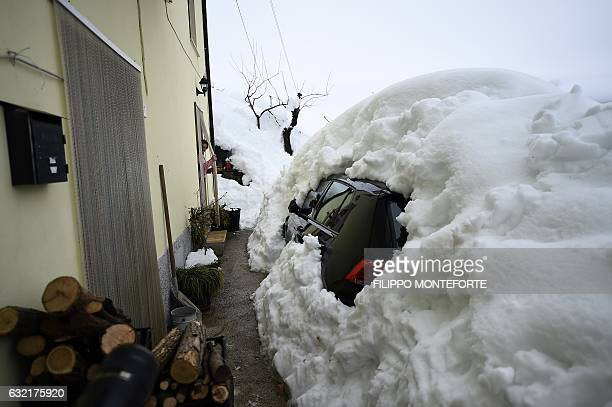 A vehicle is covered in snow in the town of Farindola some 7 kilometres from the site of an avalanche that engulfed the Hotel Rigopiano in...