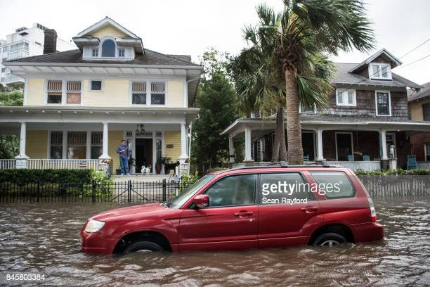 A vehicle is inundated by storm surge flood waters from Hurricane Irma along the St Johns River on Sept 11 2017 in Jacksonville Florida Flooding in...
