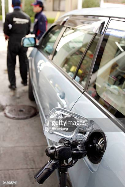 A vehicle is refueled at a Cosmo Oil Co gas station in Tokyo Japan on Tuesday Jan 15 2008 Japan's consumer confidence dropped to its lowest level in...