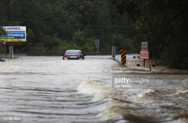 A vehicle is seen abandoned in a flooded road after Hurricane Sally passed through the area on September 16 2020 in Pensacola Florida The storm...