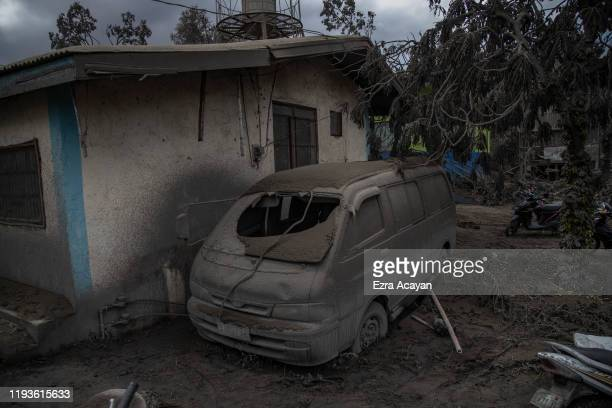 A vehicle is seen covered in volcanic ash from Taal Volcano's eruption on January 14 2020 in Laurel Batangas province Philippines The Philippine...