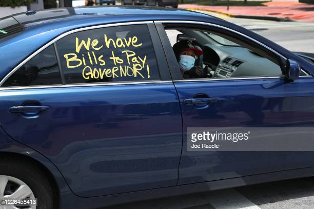 Vehicle is seen in a caravan protest asking the state of Florida to fix its unemployment system on May 22, 2020 in Miami Beach, Florida. Unemployed...
