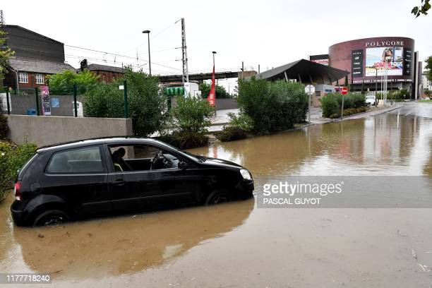 A vehicle is stuck in a flooded area following overnight storms in Bezier southern France on October 23 2019