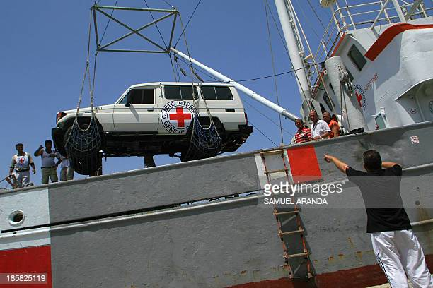 A vehicle is unloaded from a ship chartered by the International Committee of the Red Cross to transport aid supplies to southern Lebanon 12 August...