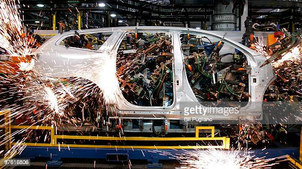 A vehicle is welded by robot arms as it goes through the assembly line at the General Motors Lansing Delta Township Assembly Plant March 10 2010 in...
