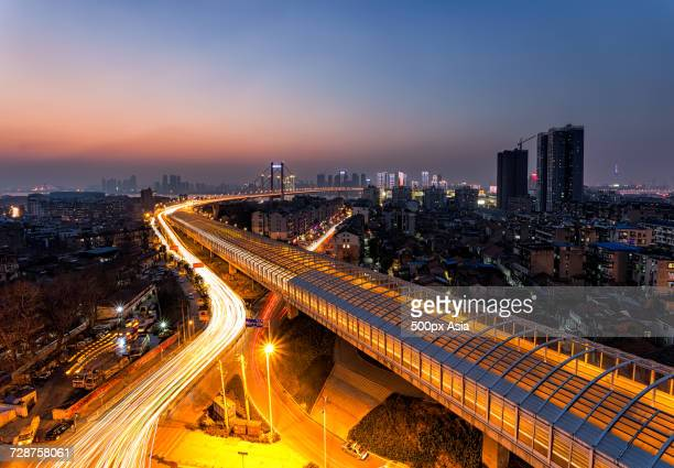 vehicle light trails on elevated city road at dusk, wuhan, hubei, china - wuhan city stock photos and pictures