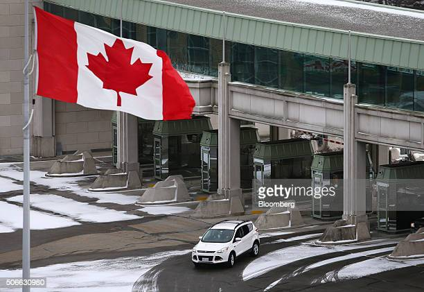 A vehicle makes its way through the Canadian border crossing in Niagara Falls Ontario Canada on Jan 23 2016 A 34 percent plunge in the Canadian...