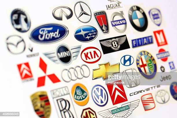 vehicle manufacturer logos - vehicle brand names stock photos and pictures