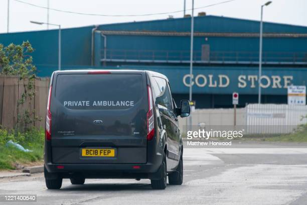 A vehicle marked 'Private Ambulance' arrives at the Wild Water Group cold storage warehouse the site of a temporary mortuary facility established at...