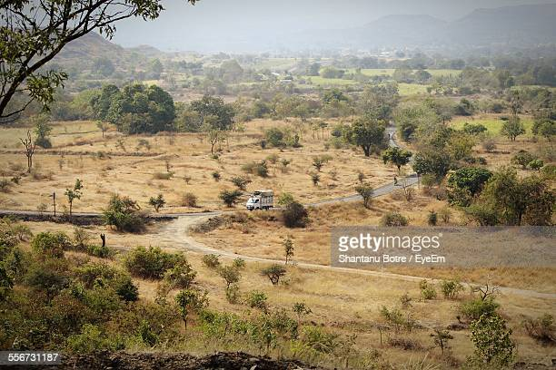 Vehicle Moving On Road Passing Through Landscape