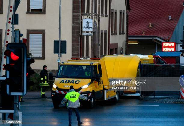 A vehicle of Germany's ADAC car club with a trailer is used to transport the perpetrator's car off the site where a man who drove into a carnival...