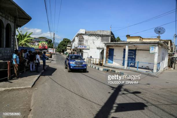 A vehicle of the Comoros Gendarmerie patrols the deserted streets of Mutsamudu the capital of the Comoros archipelago island of Anjouan on October 20...