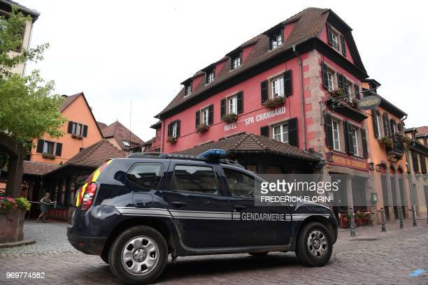 A vehicle of the French Gendarmerie drives past the Chambard hotel on June 8 2018 in the eastern France region of Alsace village of Kaysersberg where...