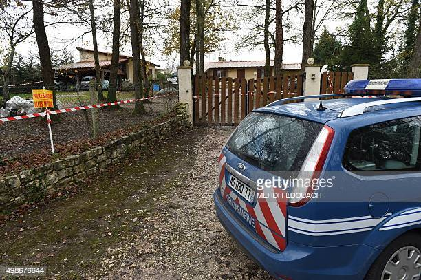A vehicle of the gendarmerie is parked outside a house where an outbreak of the deadly H5N1 bird flu virus has been detected in chickens on November...