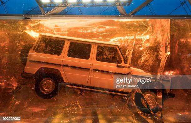 A vehicle of the new GClass by Mercedes is cast in acrylic glass in front of the NAIAS entrance at the Detroit Auto Show in Detroit US 16 January...