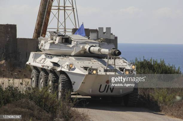 Vehicle of the UN peacekeeping force UNIFIL is seen as it stands guard upon arrival of Lebanese and Israeli committee, in the southernmost area of...
