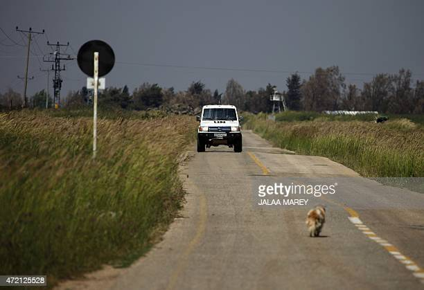 A vehicle of the United Nations Disengagement Observer Force drives near the border with Syria in the Israelioccupied sector of the Golan Heights on...