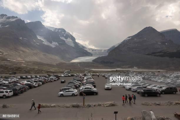 Vehicle parking lot Icefield Center Athabasca Glacier Jasper National Park visitors Alberta Canada