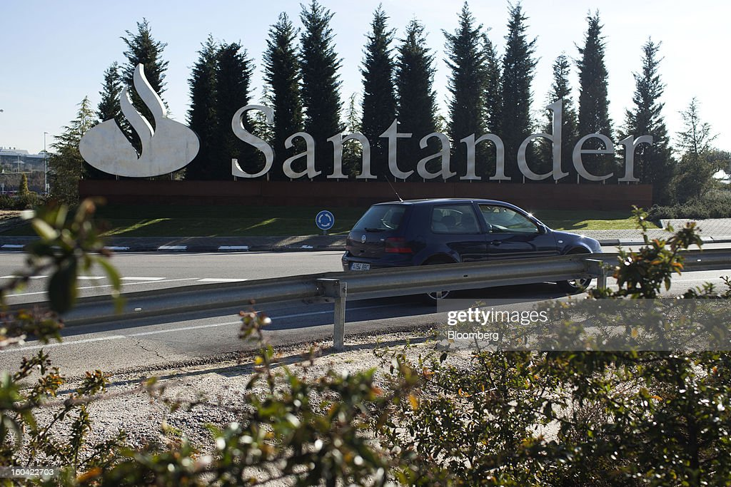 A vehicle passes a sign outside the offices of Banco Santander SA in Madrid, Spain, on Thursday, Jan. 31, 2013. Banco Santander SA posted a fourth-quarter profit that missed analyst estimates as Spain's biggest lender set aside money for further loan losses in its home market and earnings slumped in Brazil and Britain. Photographer: Angel Navarrete/Bloomberg via Getty Images