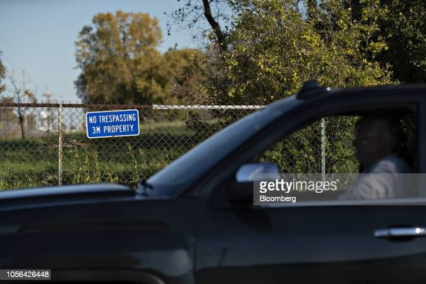 A vehicle passes in front of a 'No Trespassing' sign outside a 3M Co disposal site in Oakdale Minnesota US on Thursday Oct 18 2018 3M's Cottage Grove...