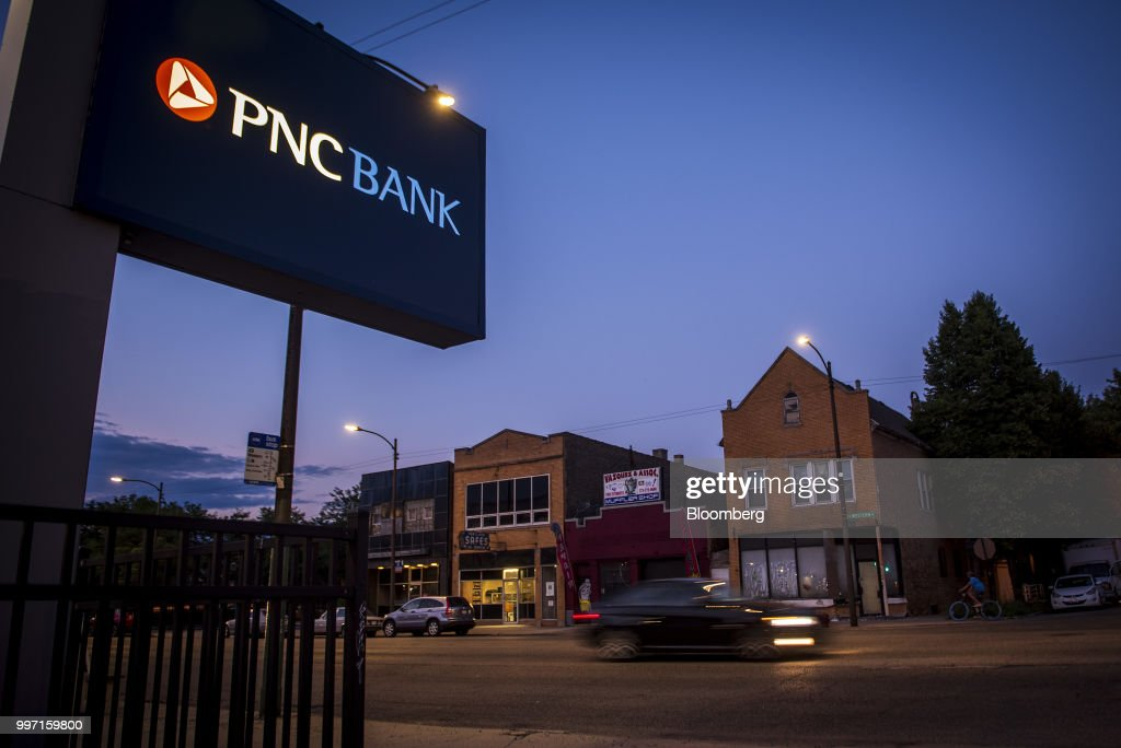 A vehicle passes in front of a PNC Financial Services Group Inc. bank branch in Chicago, Illinois, U.S., on Tuesday, July 10, 2018. PNC Financial Services Group Inc. is scheduled to release earnings figures on July 13. Photographer: Christopher Dilts/Bloomberg via Getty Images
