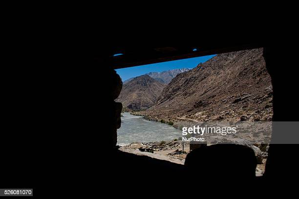 A vehicle passes on a highway nest to the Indus river flowing towards Pakistan administered Kashmir on July 30 2015 in Drass 142 km east of Srinagar...