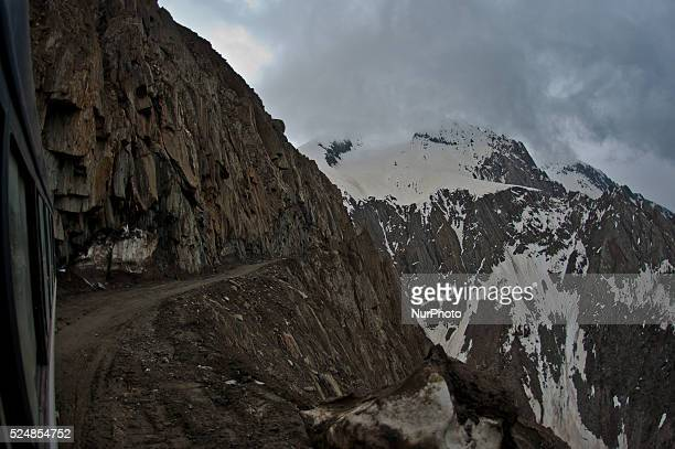 A vehicle passes through the snowcleared SrinagarLeh highway on a treacherous pass after it was reopened by authorities on May 13 2015 in Zojila 108...