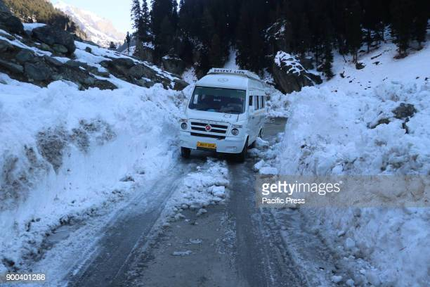 A vehicle passing through a road post snowfall in Pahalgam the famed tourist resort in south Kashmir district of Anantnag 100 Km south of Srinagar...