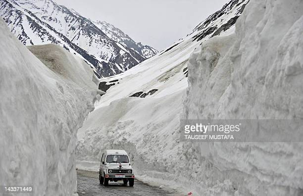 A vehicle plies the SrinagarLeh highway in Zojila about 108 km east of Srinagar on April 25 2012 The 443 km long highway was opened for the season by...