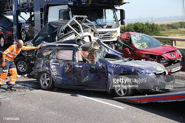 A vehicle recovery worker pushes a car onto a trailer at major traffic accident on the A249 Sheppey crossing bridge in Kent on September 5 2013 in...