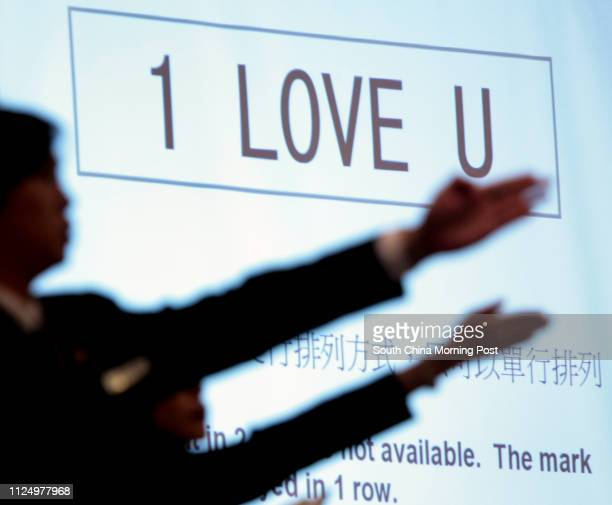 Vehicle registration marks 1 LOVE U which costS HKD 1000 during an auction of personalized vehicle registration plates at Hong Kong Convention and...