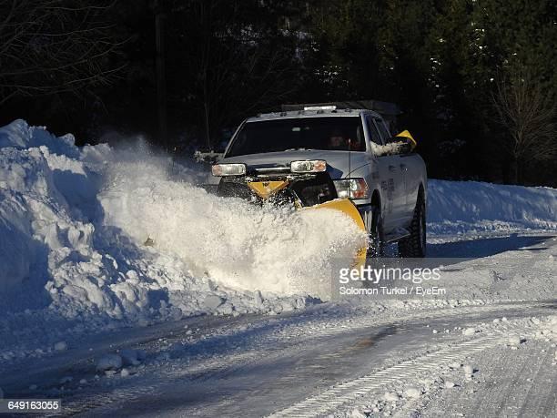 vehicle removing snow from street - solomon turkel stock pictures, royalty-free photos & images