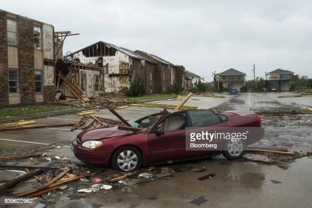 A vehicle sits damaged by debris after Hurricane Harvey hit Rockport Texas US on Saturday Aug 26 2017 As Harvey's winds die down trouble for Texas...