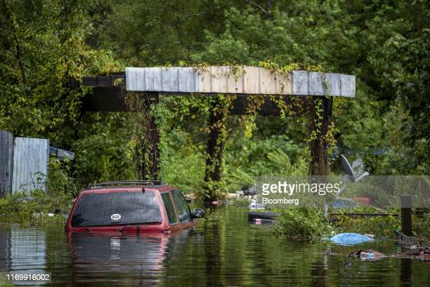 A vehicle sits submerged in flood water following Tropical Storm Imelda in Fannett Texas US on Friday Sept 20 2019 The remnants of Tropical Storm...
