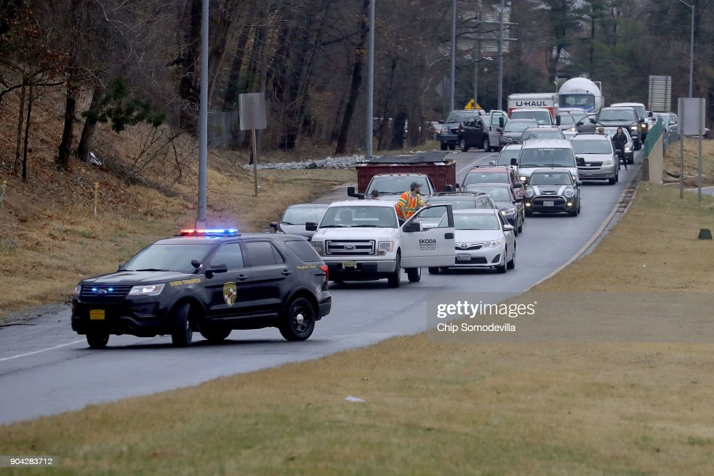 Vehicle traffic is kept off the Capital Beltway as U.S. President Donald Trump's motorcade heads to Walter Reed National Military Medical Center for his annual physical examination January 12, 2018 in Bethesda, Maryland. Trump will next travel to Florida to spend the Dr. Martin Luther King Jr. Day holiday weekend at his Mar-a-Lago resort.